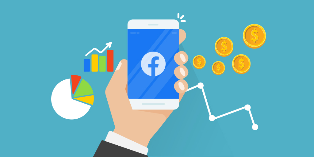 Hand holds a phone with a Facebook logo on it. Money and various graphs float in the background to represent paid advertising and its metrics