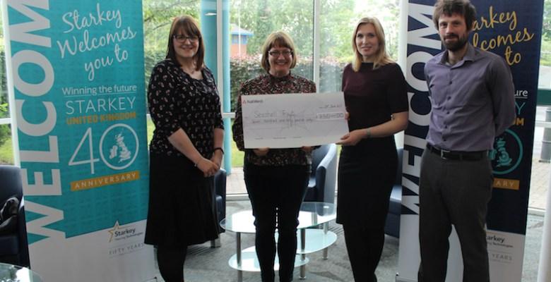 Starkey Hearing Technologies present a cheque to Seashell Trust