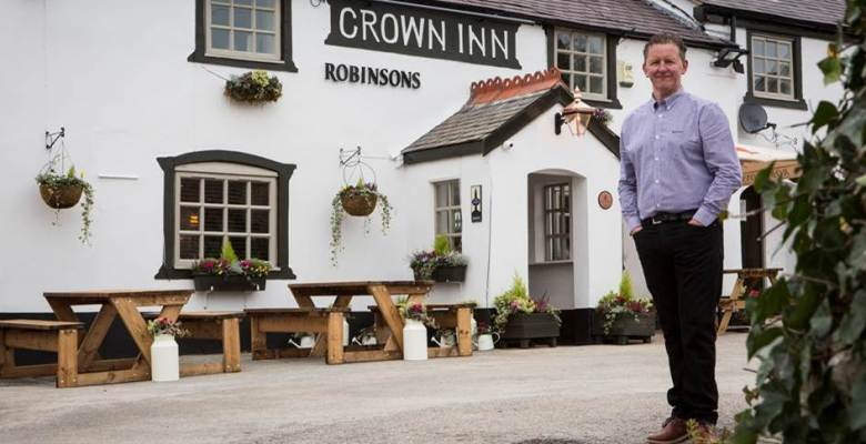 Robinsons Licensee, Anthony Griffiths, outside his newly refurbished pub