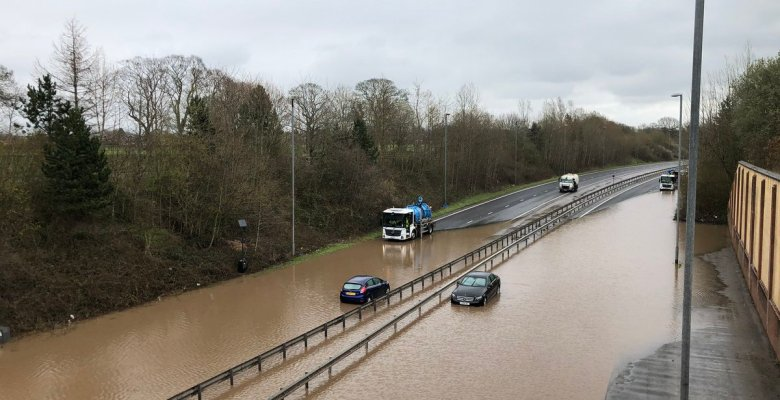 12 noon - Work is underway to clear the flooded A555