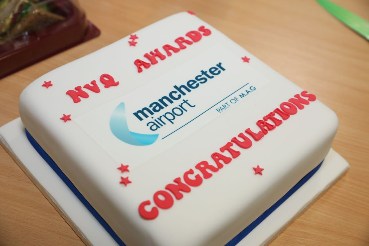 NVQ recipients at Manchester Airport Academy shared a cake to celebrate success