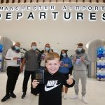The Thompson family - the first passengers to fly out of Manchester Airport's new Terminal Two