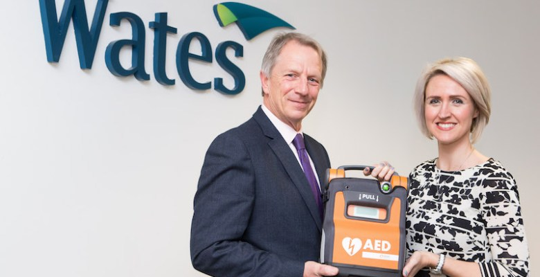 Richard MacDonald and Kelly Osborne during the handover of one of the defibrillators at the companies Sharston office, which are set to be deployed throughout the Water Group.