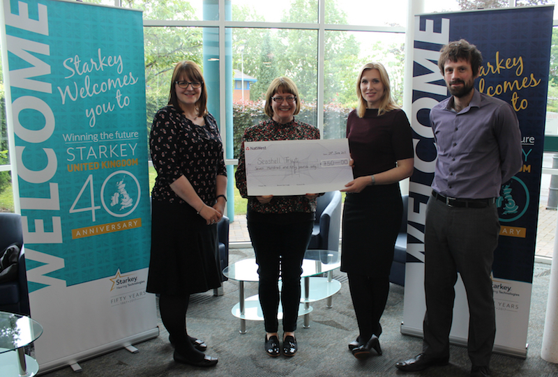 Starkey Hearing Technologies present a cheque to Seashell Trust