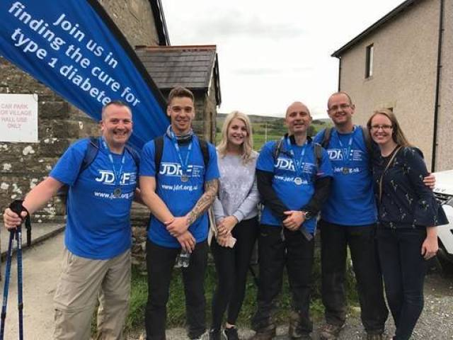 Rick Pennell, Theo Hall, Molly Marsden, Steven Byrne, Richard Brown, Caroline Patten at the finish line.