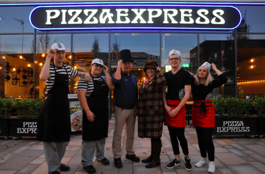 Stockport Council museum staff visit Stockport's new PizzaExpress who are paying homage to Stockport's hatting history inside their new restaurant.