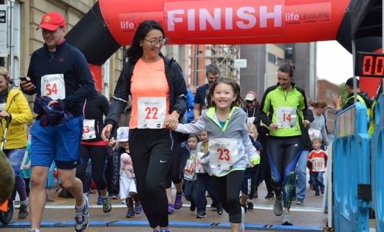 Family fun run crossing the line 2018 Stockport