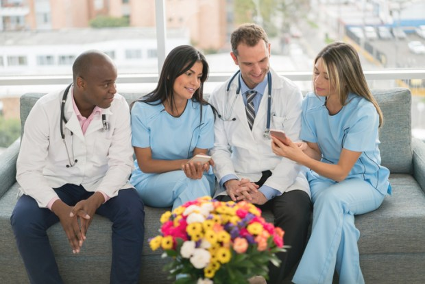 Medical staff on phone creating healthcare social media plan