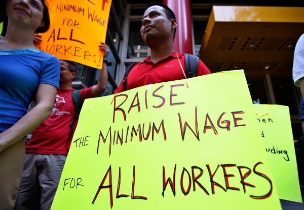 Image: Low wage workers take part in a protest organized by the Coalition for a Real Minimum Wage outside the offices of New York Governor Andrew Cuomo,