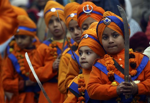 Sikh children dressed in traditional attire participate in a procession to mark the birth anniversary of the 10th Sikh Guru Gobind Singh in Jammu, India, Saturday, Jan. 3, 2009. (AP Photo/Channi Anand)