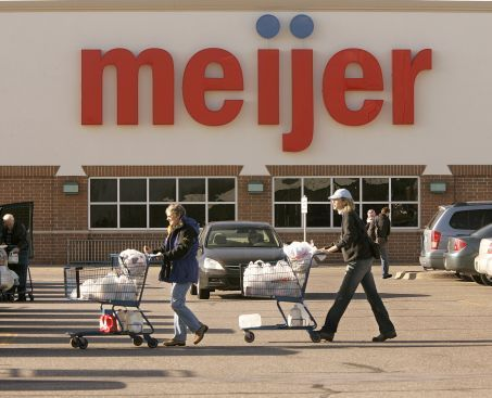 Shoppers head to their vehicles at the Meijer at Knapps Corner in Grand Rapids on the Beltline in Grand Rapids Township ( Rex Larsen )