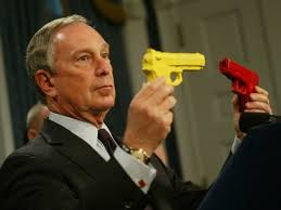 Bloomberg playing with toy guns.
