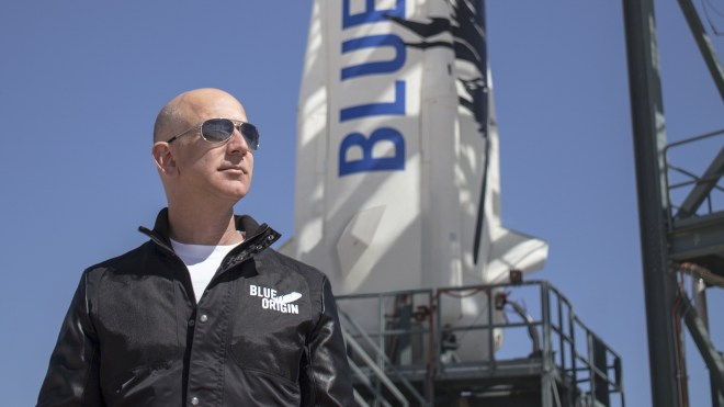 Jeff Bezos in a Mussolini-esque poise with one of his playtoys.