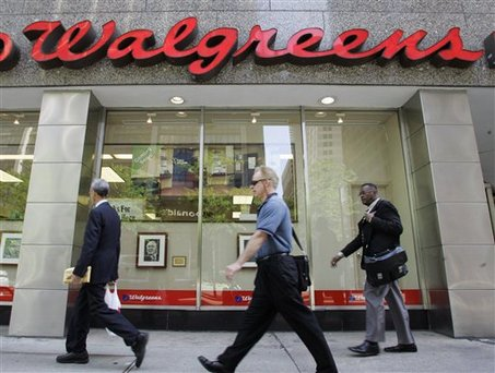 **FILE** In this June 23, 2008 file photo, pedestrians walk past a downtown Chicago Walgreens store. Drugstore operator Walgreen Co. said Monday, Dec. 22, 2008, its profit fell 10 percent in the fiscal first quarter because of costs to open more than 200 new stores. (AP Photo/Russel A. Daniels, file)