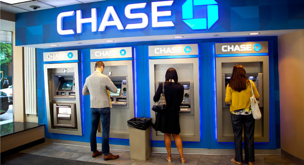 Customers use automated teller machines (ATM) at a JPMorgan Chase & Co. bank branch in New York, U.S., on Monday, June 20, 2011. JPMorgan Chase & Co. plans to sell five-year notes for the first time since February as relative borrowing costs for lenders climbed to the highest this year. Photographer: Robert Caplin/Bloomberg via Getty Images