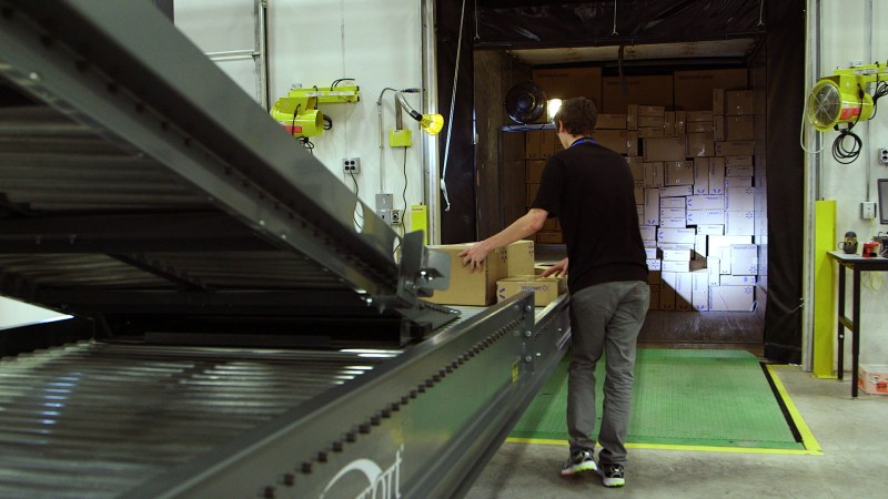 walmart-e-commerce-fulfillment-center-worker-loading-trailer
