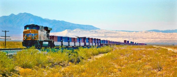 [MOJAVE NATIONAL PRESERVE: The Union Pacific, an hourly sight (and sound) in the Mojave. The singing Kelso Dunes are in the background.] *** []