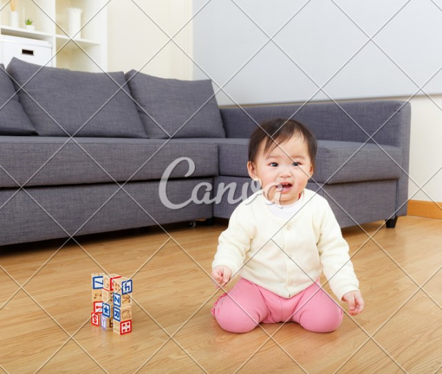 Asian Baby Girl Play With Toy Block At Home