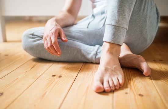 barefoot man sitting on