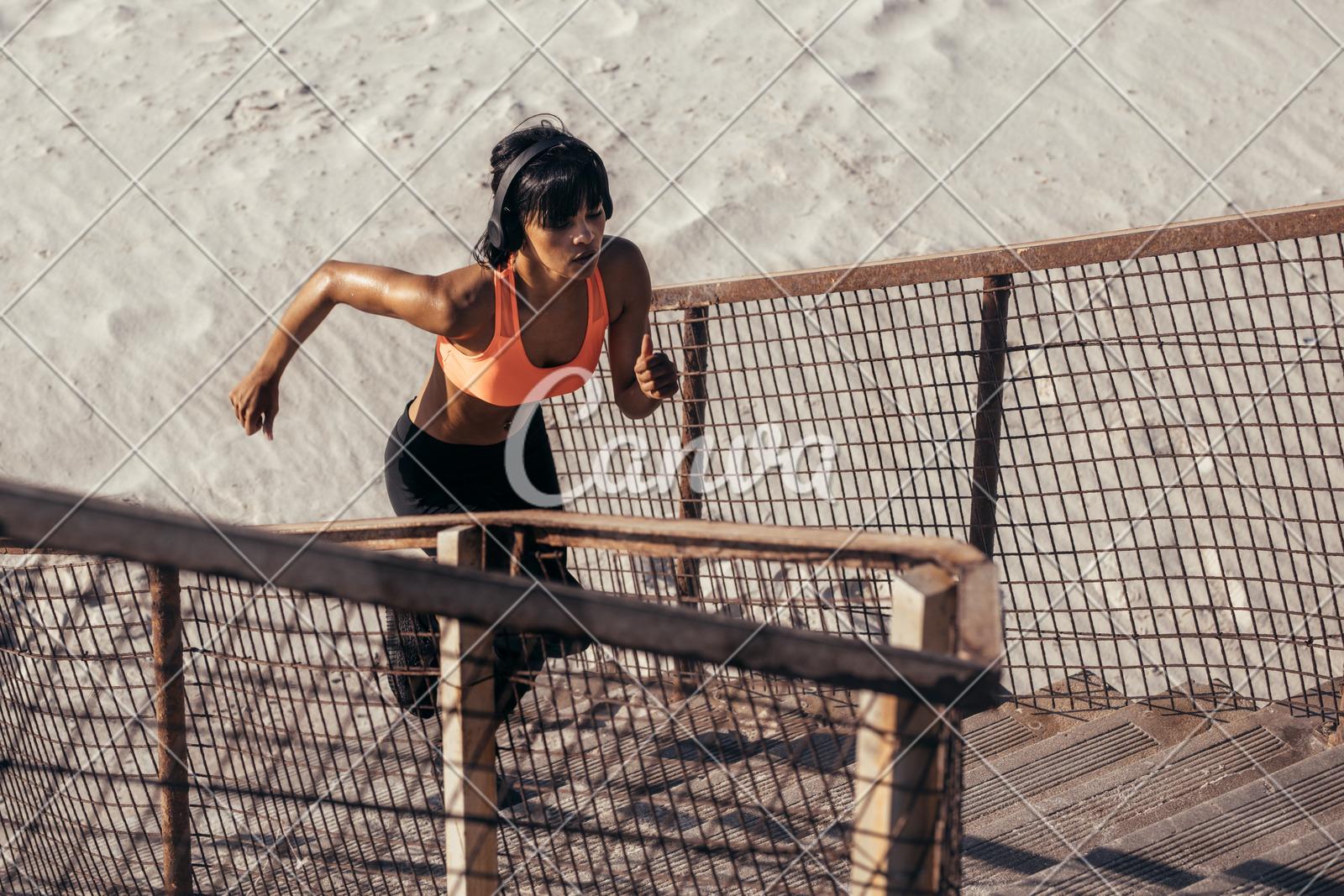 runner climbing steps on