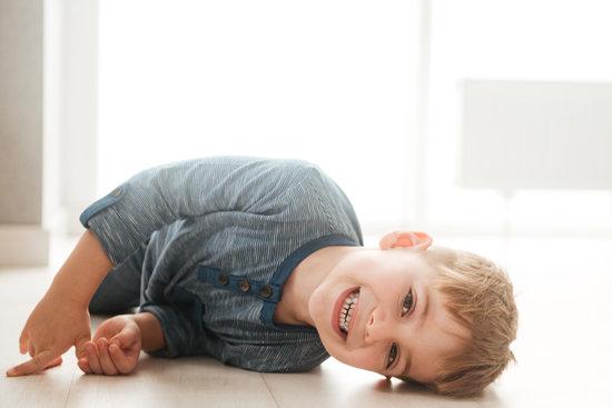 little boy lies on