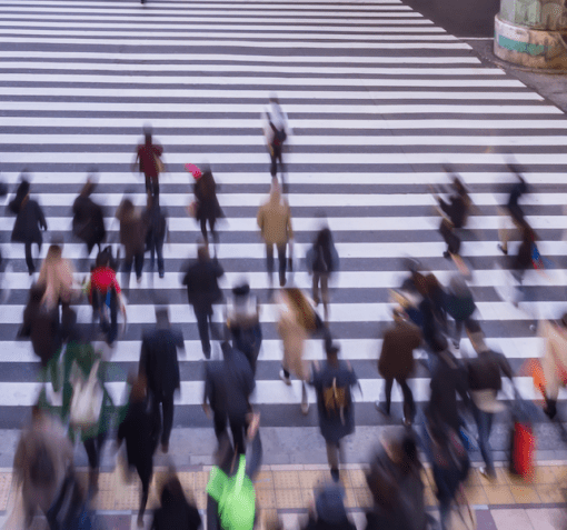 people walking across the crosswalk for fractional cgo services