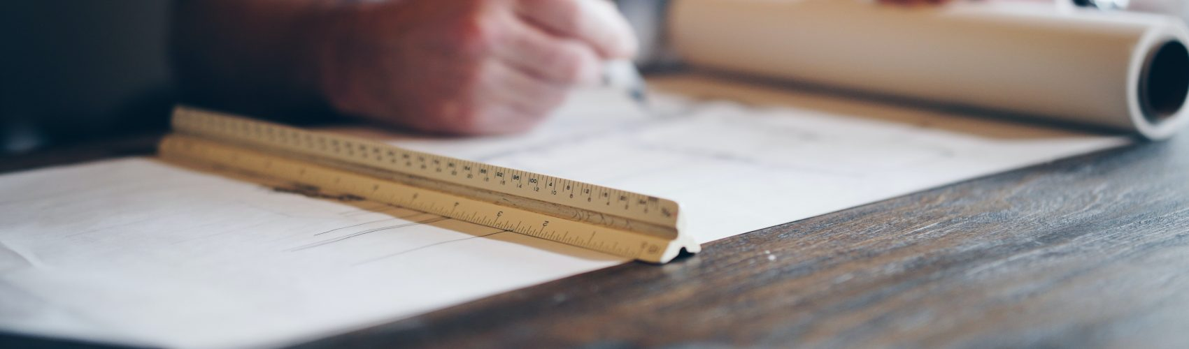 man creating blueprint
