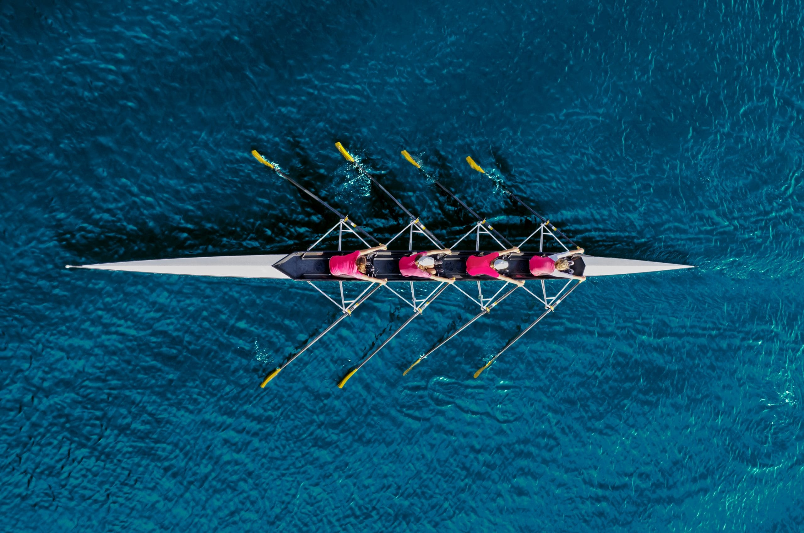 teamwork - group rowing boat