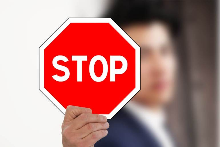 person holding stop sign