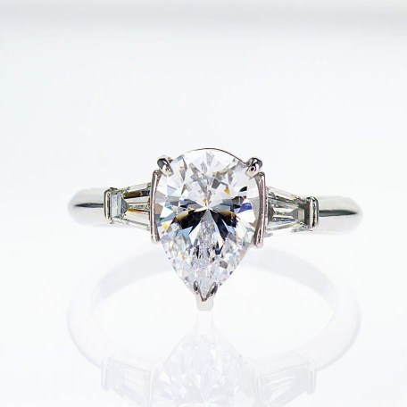 Unique Engagement Ring with a Pear Shape Diamond