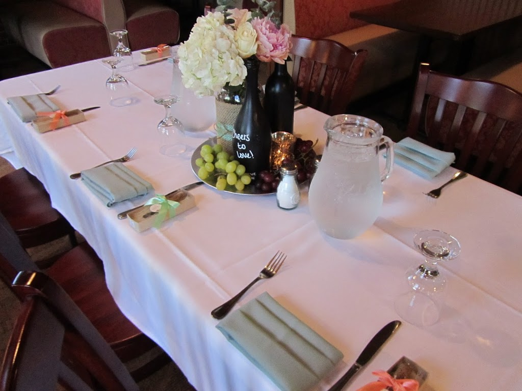 Wine-themed bridal shower guest table centerpieces