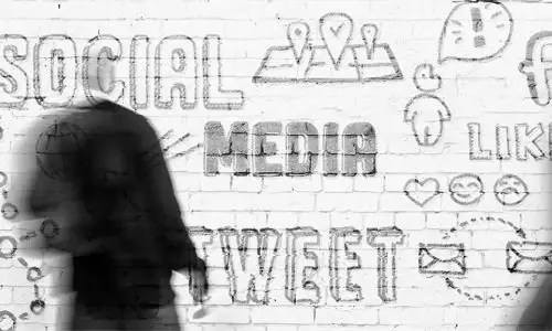A wall covered in social media graffiti