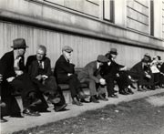 """""""Unemployed Men sitting on the sunny side of the San Francisco Public Library"""" by Dorothea Lange. Feb. 1937. Courtesy of the San Francisco History Center."""