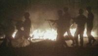 sq_on_fire_AK47s