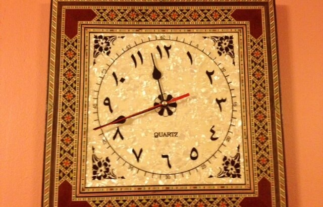 A Clock with Arabic numerals