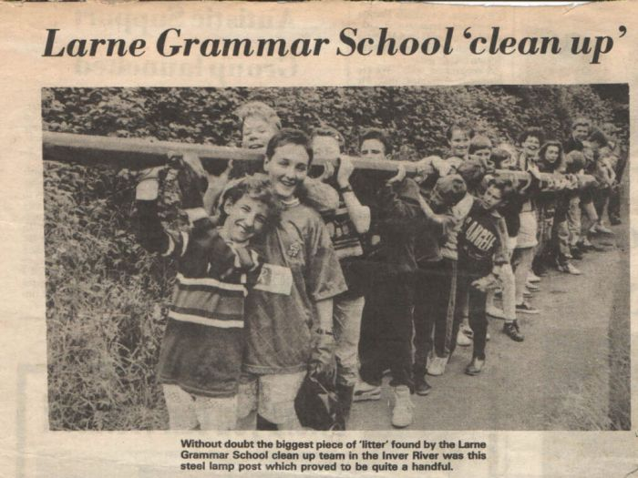 Larne Grammar School Conservation Group remove a lamp post from a local river