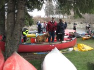 The race ends at a small park near the confluence of the Kenduskeag stream and Penobscot River. Racers haul their boats up a steep, rocky river bank and plant their canoes in the park. The park fills up fast with racers and their fans.