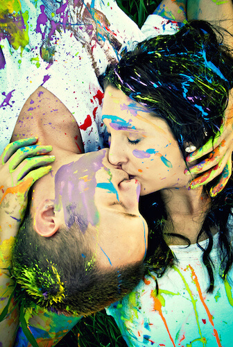 Paint-covered lovers kissing