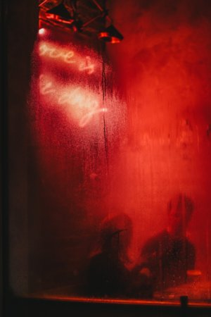 When to break up - couple behind a red window