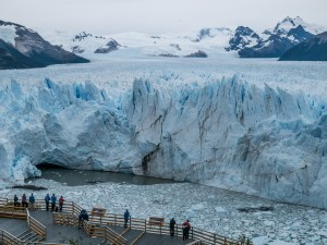 """EL CALAFATE / ARGENTINA - We all tend to exclude tourists from our landscape shots, but sometimes it's good to include people to show the magnitude of a place. Perito Moreno glacier is massive and there are no good size reference points around, so I decided to include tourists in this frame to show how big it is. It's also a good way to make your viewers """"see"""" themselves there."""