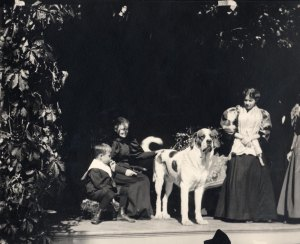Bim Pond, Susan Crane, Osmon (the dog), and Susy Clemens at Quarry Farm on September 15, 1895