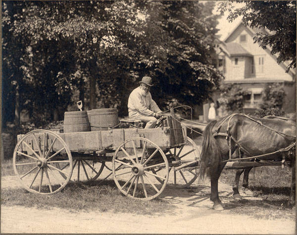 John Lewis seated on his wagon near Quarry Farm, East Hill, Elmira, New York.