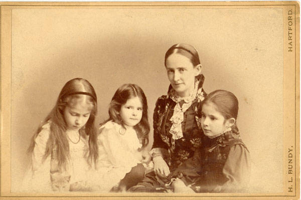 Half-length portrait of Samuel Clemens' wife and daughters, left to right, Susy, Jean, Olivia and Clara.