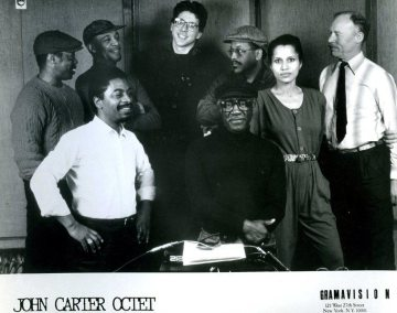 Publicity still -- circa 1986 New York City -- front row: Fred Hopkins and John Carter; back row: Andrew Cyrille, Benny Powell, Marty Ehrlich, Bobby Bradford, Terry Jenoure, Don Preston -- photographer unknown, from the collection of Bobby Bradford