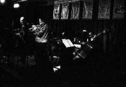 Bobby Bradford Mo'tet -- old Outpost -- Albuquerque, April 21, 1995 -- Vinny Golia, baritone sax; Bobby, cornet; William Jeffrey, drums; Roberto Miranda, bass -- photo by Mark Weber
