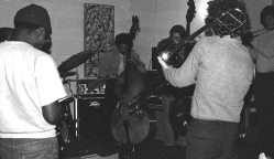 Sunday afternoon jam session at The Little Big Horn -- November 28, 1976 -- Glenn Ferris, trombone (his back to camera); Bobby Bradford, cornet; Roberto Miranda & Richard Rehwald, basses; Vinny Golia, bass clarinet; James Newton, flute; John Carter, soprano sax & clarinet -- photo by Mark Weber