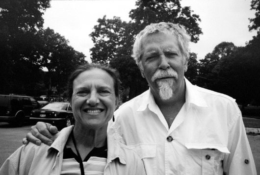 Janet & Mark -- photo by saxophonist Hal McKusick -- July 9, 2009 -- the late Hal McKusick was also an accomplished photographer -- on this shot he asked to use my Olympus 35RC while we were in parking lot of The Hampton Maid, Hampton Bays, Southampton, Long Island, a wonderful restaurant we regularly had breakfast there like on this mid-morning with Janet's sisters and Hal & Jan