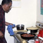 Bobby Bradford cooking his own creation Creole Negro Jazz Delight on one of his Albuquerque visits, a stop-over during a trip to NYC -- July 19, 1993 (BB's 59th birthday) -- says he still makes this dish and that his kids still ask for it -- photo by Mark Weber