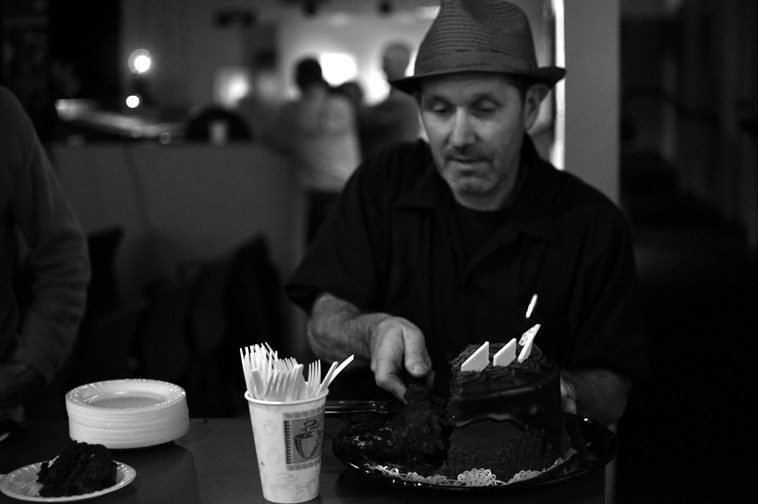 The ever-thoughtful Tom Guralnick, general manager of the Outpost, surprised us with a chocolate cake afterwards ---  it was Kazzrie's birthday on October 17th and mine was the 21st -- photo by Jim Gale