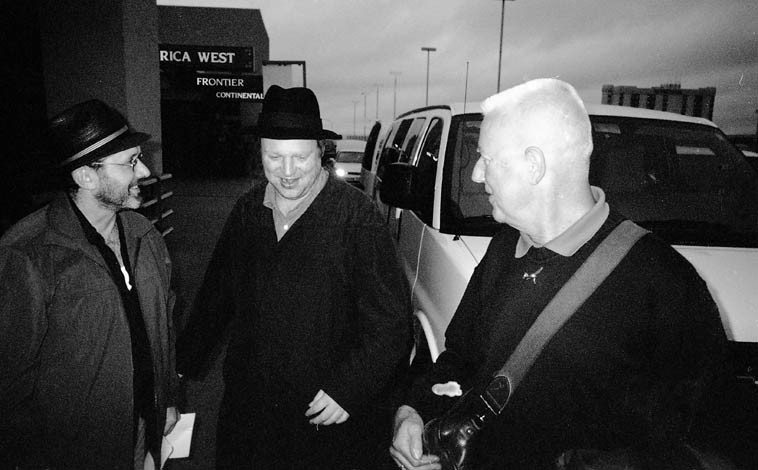 Arrival at Albuquerque Airport, October 25, 2004 -- concert producer Tom Guralnick, Toby Delius, Han  Bennink, and the transport van -- photo by Mark Weber